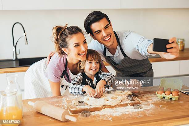Family taking a selfie while cooking