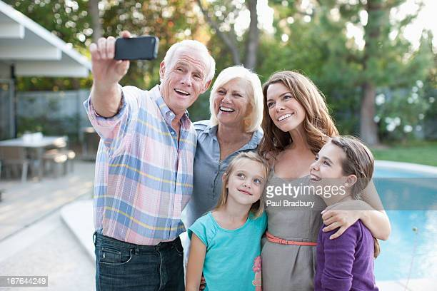 Family taking picture of themselves outdoors
