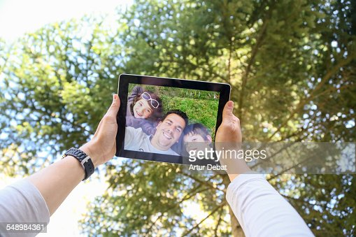 Family taking selfie from personal point of view.
