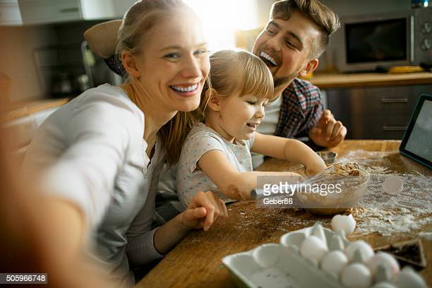 Family taking selfie while baking