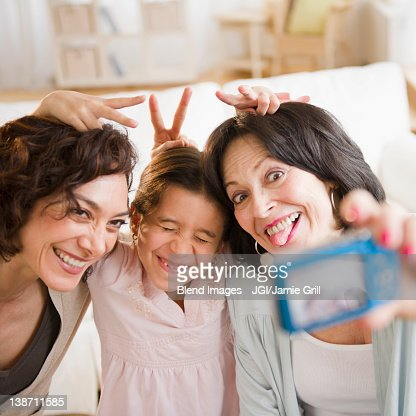 Family taking self-portrait with digital camera