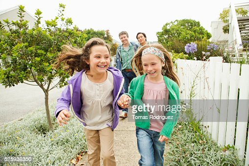 Family taking walk, girls (6-7), (8-9) : Stock Photo