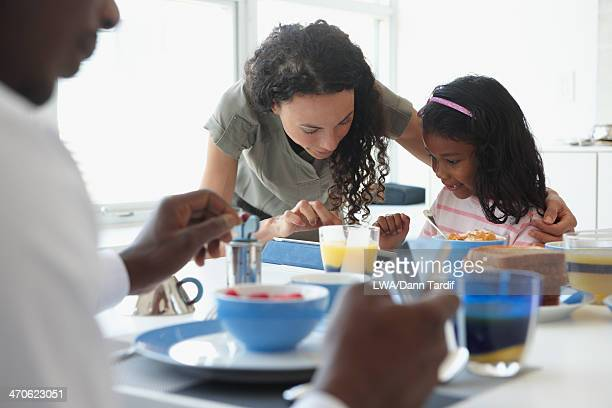 Family talking at breakfast table