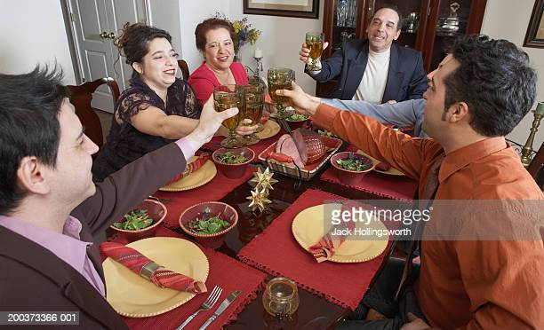 Family toasting at the dinner table