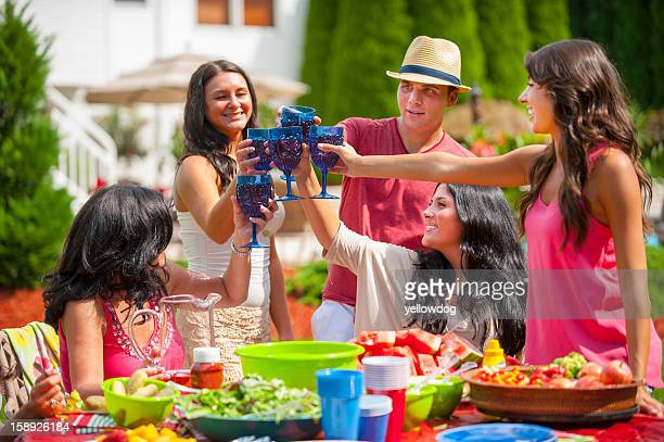 Family toasting each other outdoors