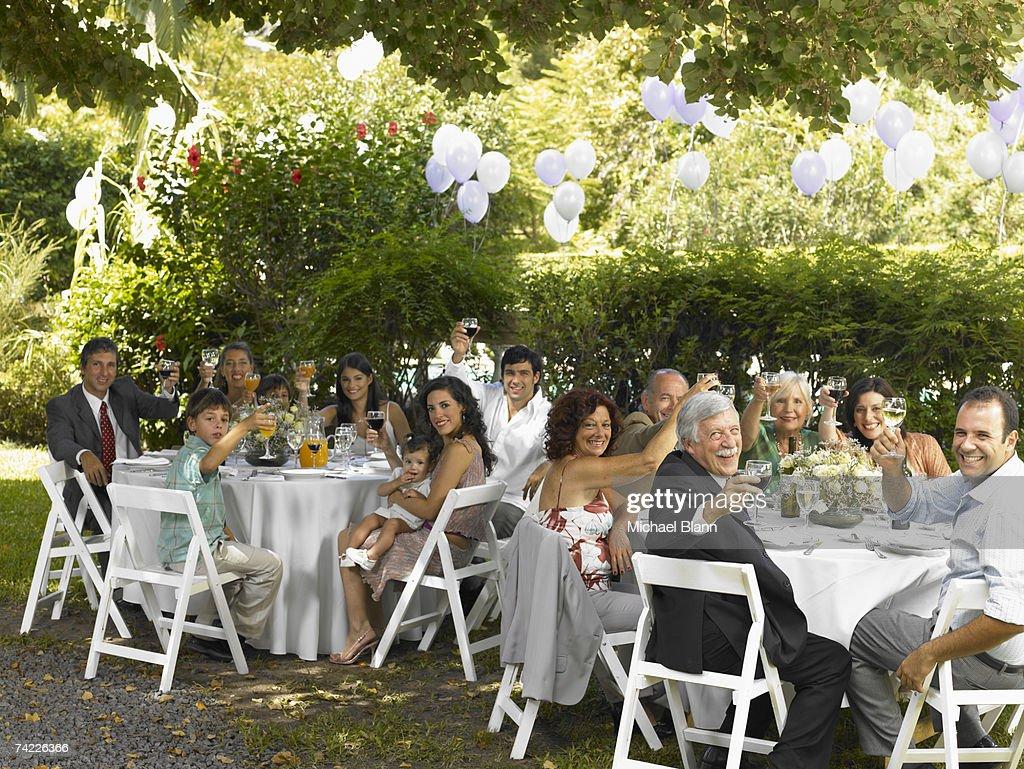 Family toasting on garden party : Stock Photo