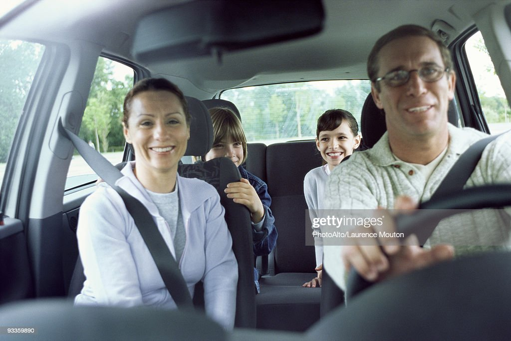 Family together in car on road trip : Stock Photo