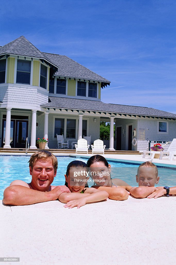 Family together in swimming pool stock photo getty images for Family swimming pool