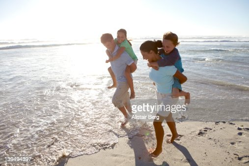 Family together on a beach : Stock Photo