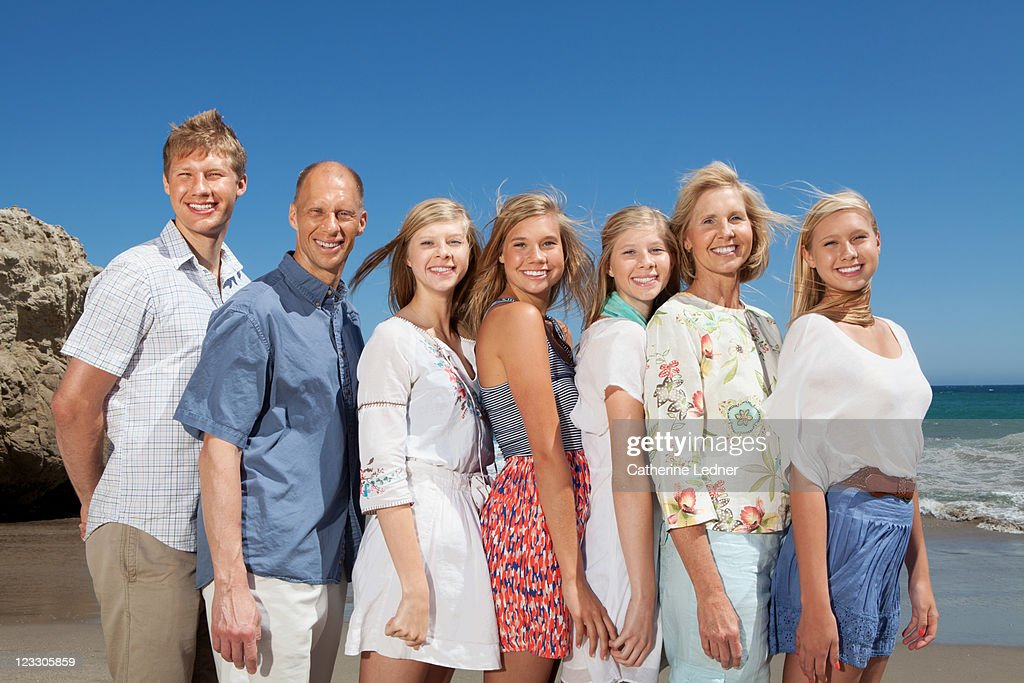 Family together on the beach : Stock Photo
