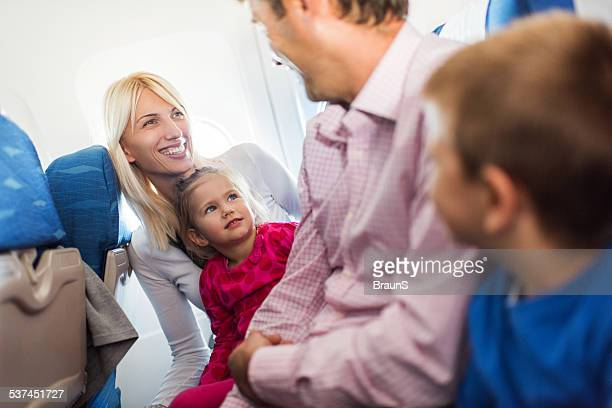 Family traveling by plane.
