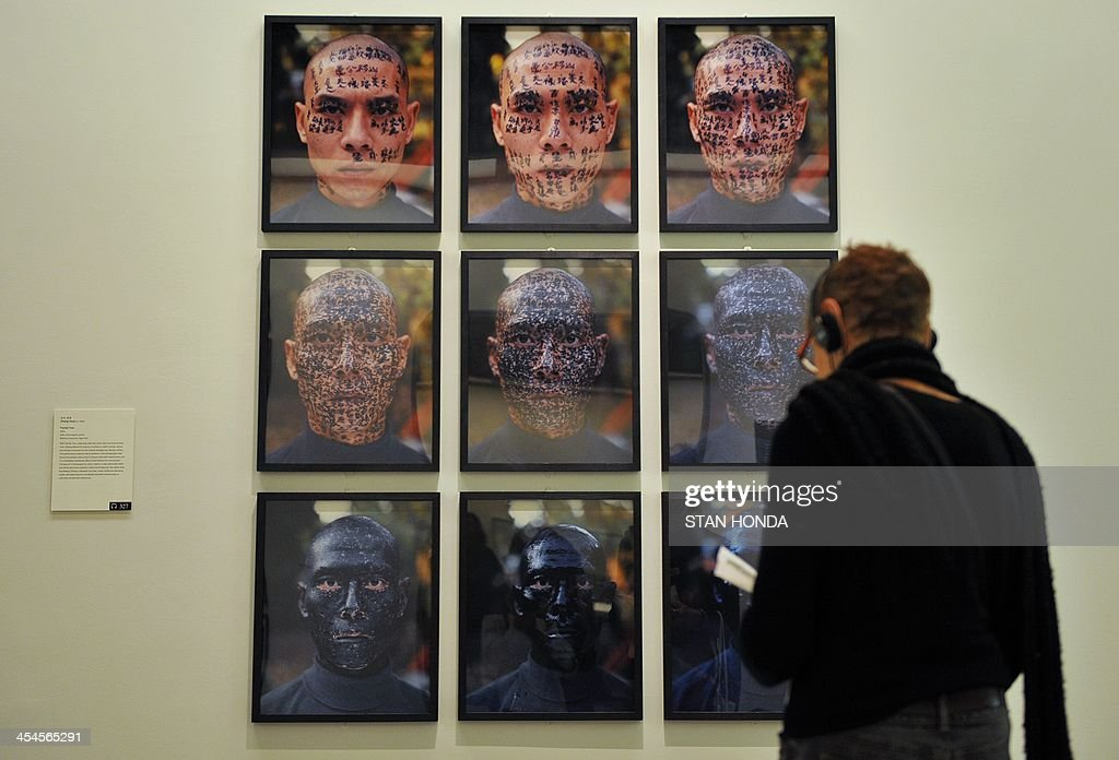 'Family Tree' by Zhang Huan, photographs of Zhang's face with inked words, is displayed in the exhibition 'Ink Art: Past as Present in Contemporary China' at the Metropolitan Museum of Art on December 9, 2013 in New York. A major exhibition of 70 pieces of art by 35 contemporary artists born in China goes on view to the public on December 11. AFP PHOTO/Stan HONDA ++RESTRICTED