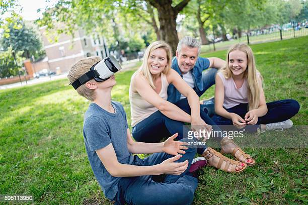 Family trying a VR device at the park