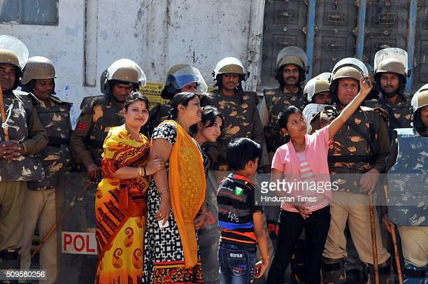 A family trying to get a selfie with police forces deployed outside the Bhojshala on February 11 2016 in Dhar India A communal flareup is feared in...
