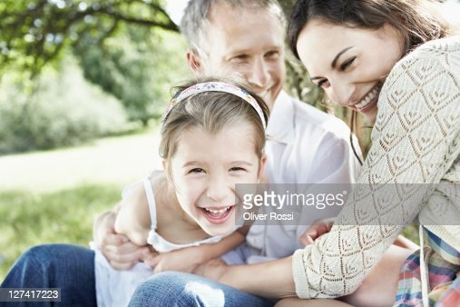 family tussle outside on a sunny day : Stock Photo