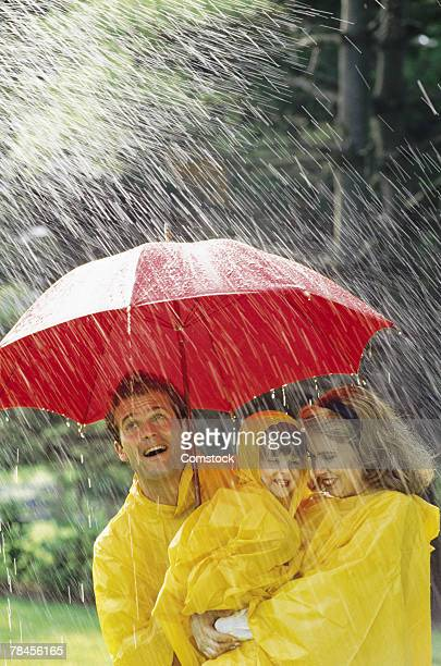Family under umbrella in the rain