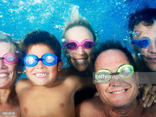 Family Under Water in Swimming Pool