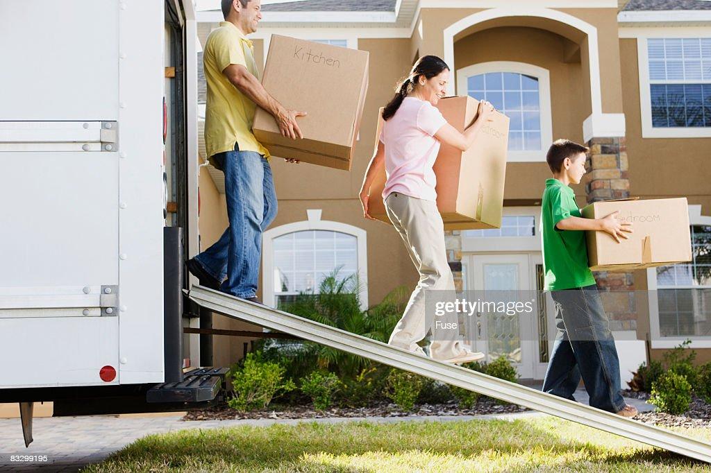 Family Unloading Moving Truck