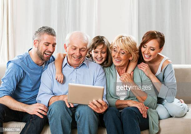 Family using a digial tablet together