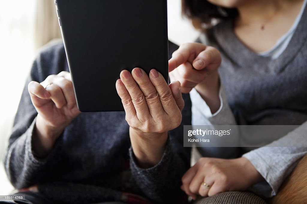 family using a digital tablet together