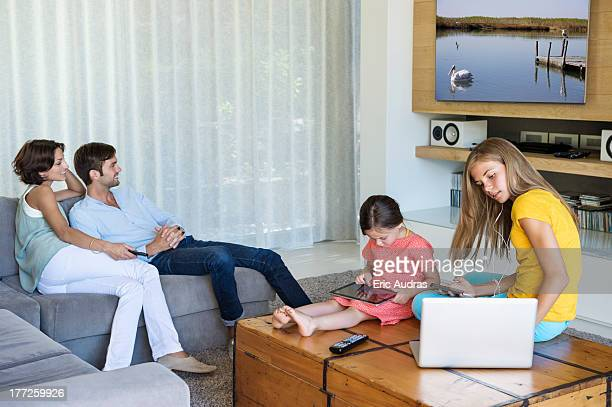 Family using electronics gadgets