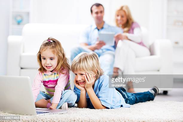 Family using laptop and digital tablet