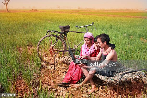 Family using Laptop in the wheat field
