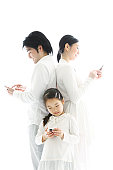 family using mobile phone