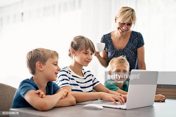 Family using modern ultrabook computer