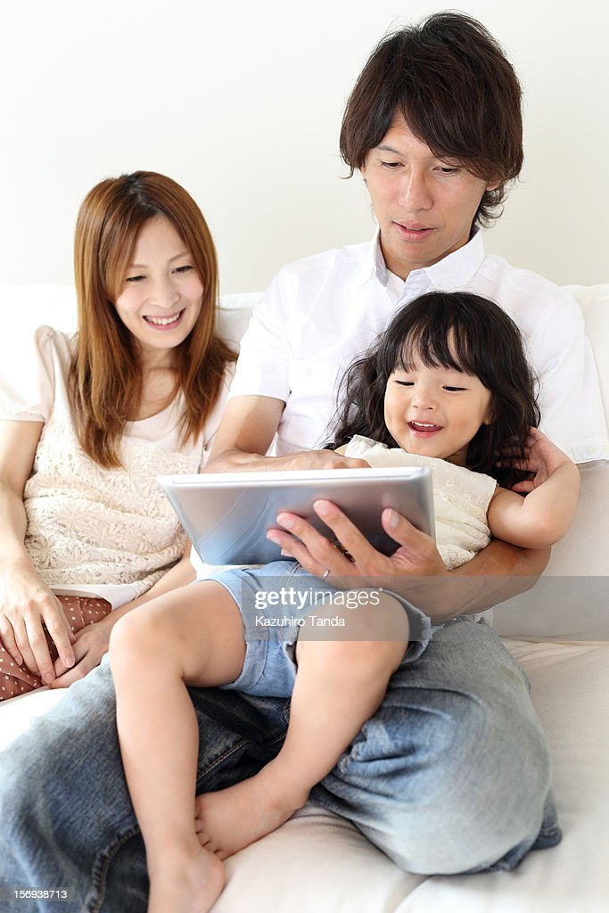 Family using tablet computer : Stock Photo