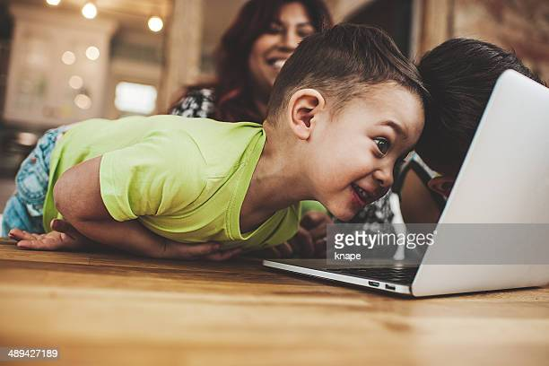 Family using the computer laptop and surfing internet