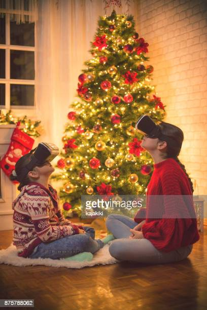 Family Using Virtual Reality Simulator on Christmas