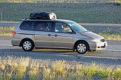 Family vacation in a gray minivan