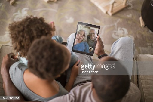 Family video chatting with digital tablet