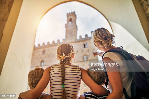 Family visiting italian town of Volterra, Tuscany