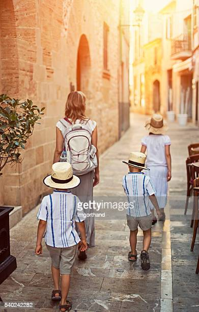 Family visiting mediterranean town of Alcudia