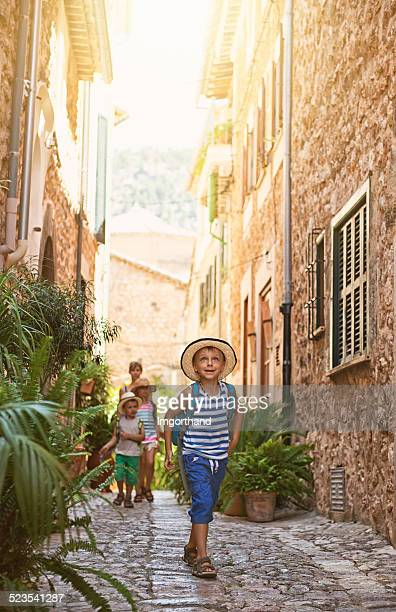 Family visiting mediterranean town.