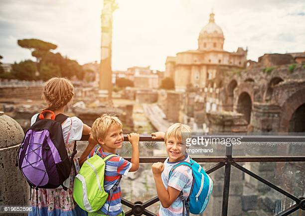 Family visiting Roman Forum in Rome, Italy