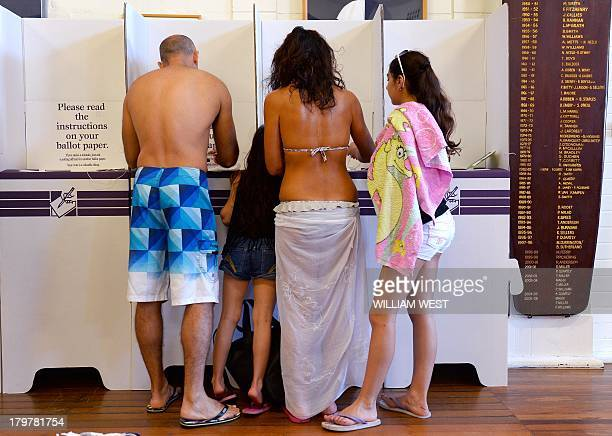 A family votes a polling station at Sydney's Bondi Beach on September 7 in Australia's general election Latest polls show conservative opposition...