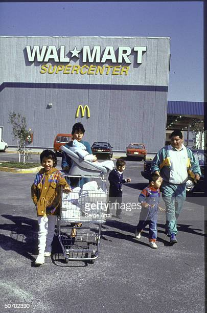 Family w cart outside WalMart supermarket