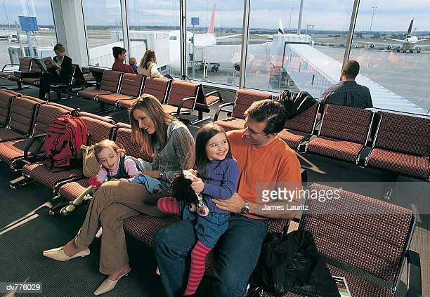 Family Waiting in An Airport Lounge