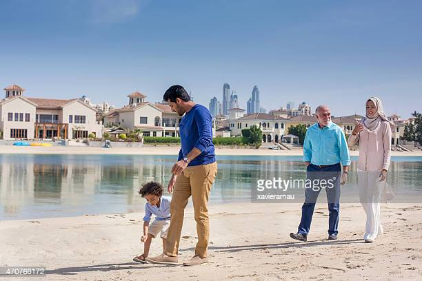 Family walk in the beach