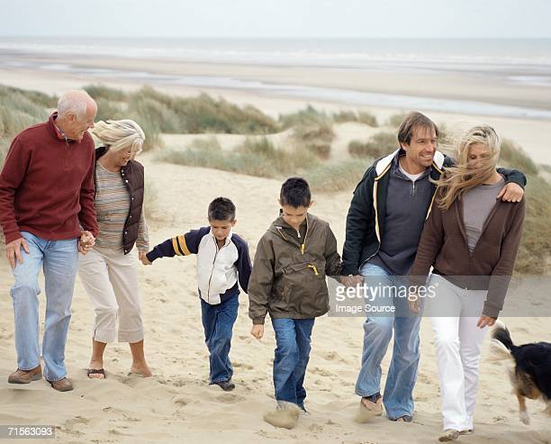 Family walking along beach