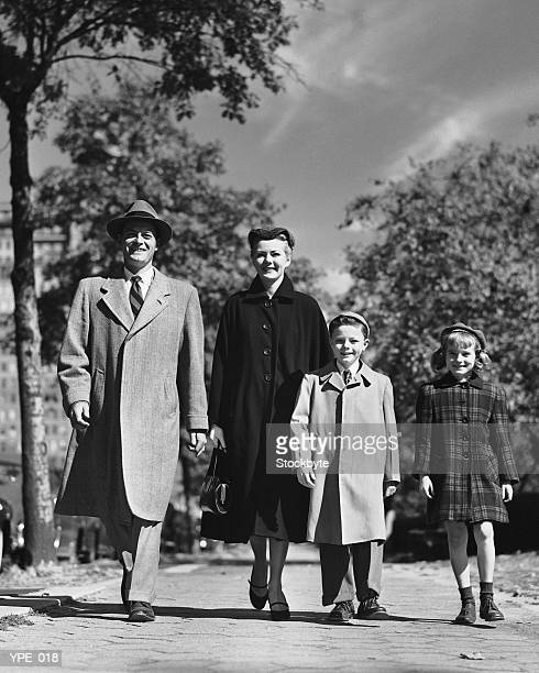 Family walking along street