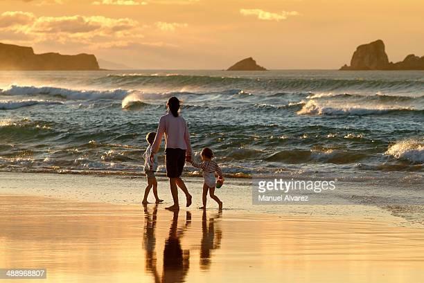 Family walking along the beach in Spain
