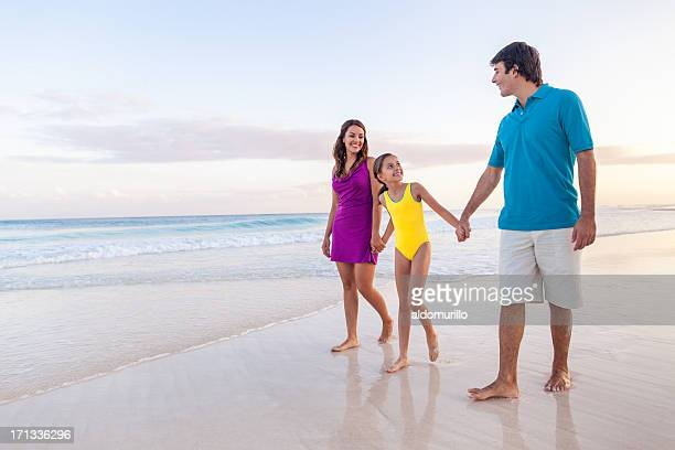 Family walking and enjoying the beach
