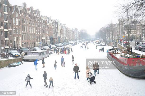 family walking and skating on ice amsterdam