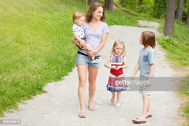 Family Walking And Talking In Park