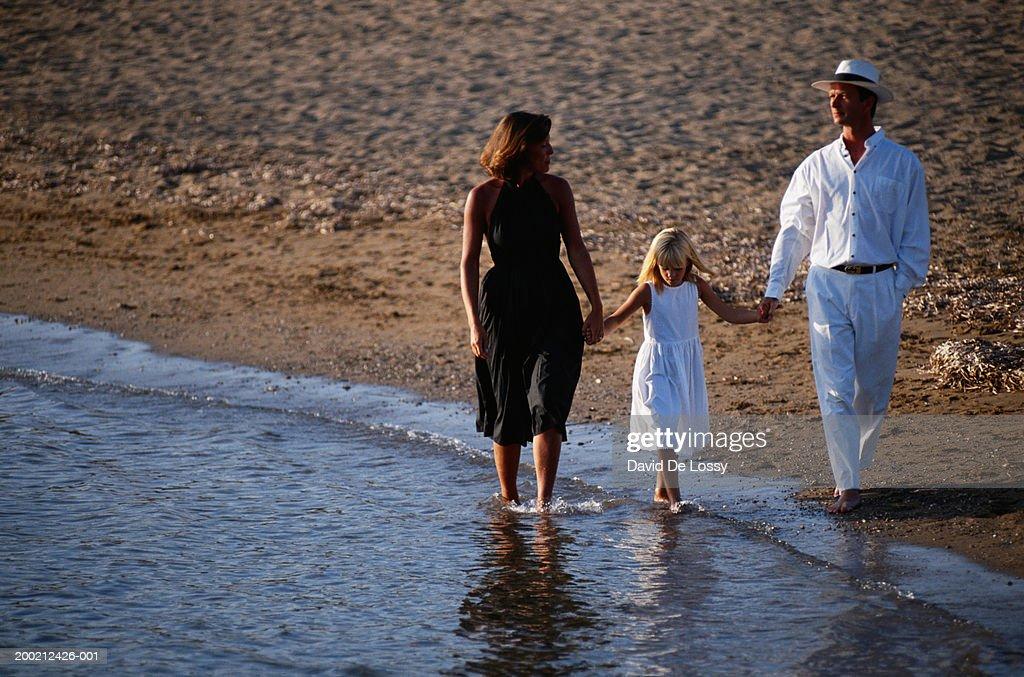 Family walking at beach side : Stock Photo