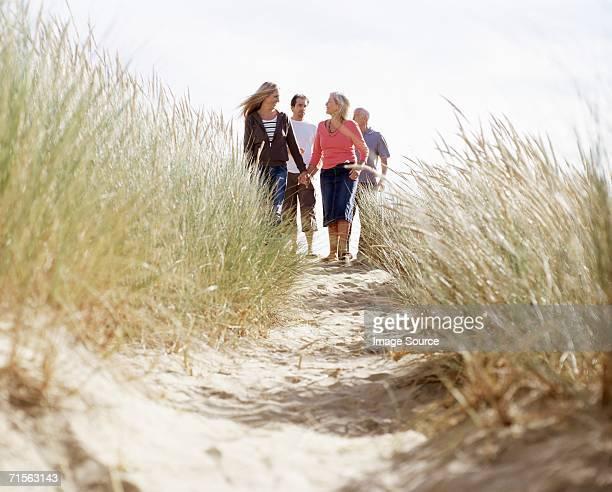 Family walking down a dune